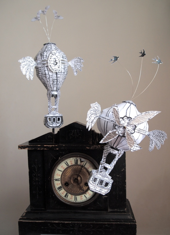 """The Escape"" balloons and clock piece £140"