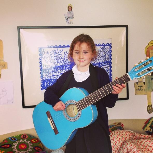 Heidi takes up the guitar!