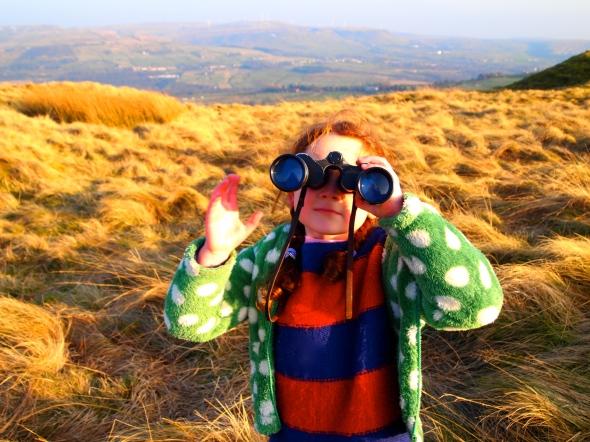 Heidi sporting her vintage binoculars on top of the Tor