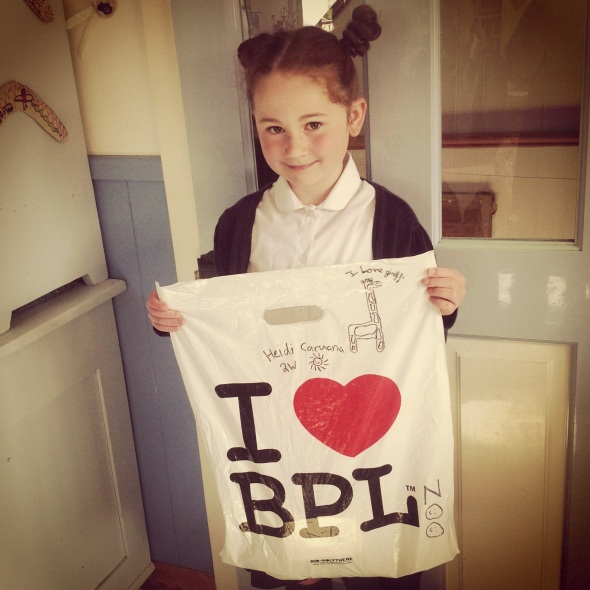 Heidi sporting a giraffe hairdo and customised bag  for her school trip to Blackpool zoo.